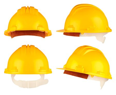 buildingsite: yellow building-site helmet set on white background Stock Photo