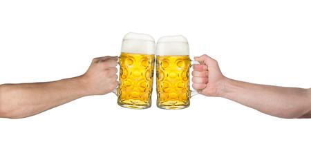man drinking beer: cheers! hands holding up german beer mugs