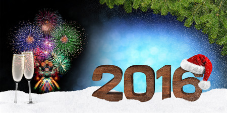 turns of the year: turn of the year concept with wooden numbers fireworks and xmas hat Stock Photo