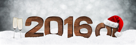 turn of the year: turn of the year concept with wooden numbers and xmas hat