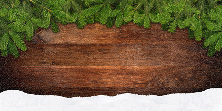 christmas tree branch: fir branches frame on wooden background