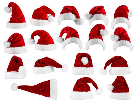 santa hat: large collection of red white santa hats Stock Photo