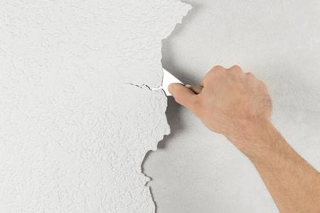 plaster removal with hand and spatula Archivio Fotografico