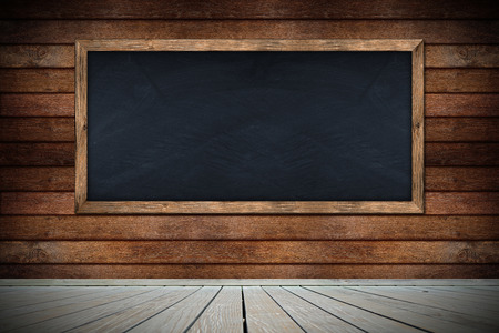 blackboard on wooden wall with floor