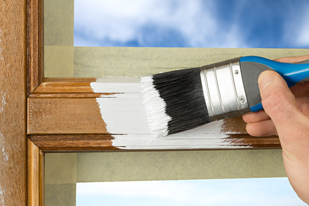 painting and decorating: pinting a window frame with white color
