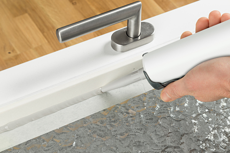 renewing of a silicone joint on a window Standard-Bild