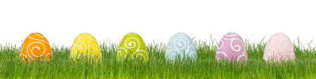 colorful decorated easter eggs on green grass