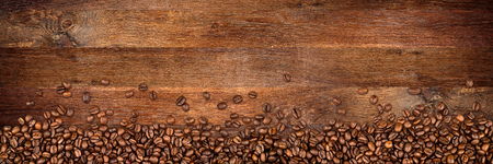 coffee beans on wide rustic oak background