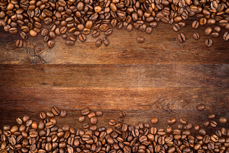 coffee  beans on rustic oak background Imagens