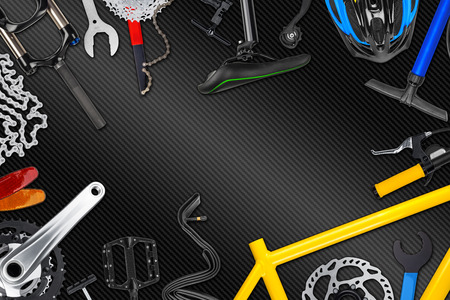 carbon fibre: bicycle frame with parts on carbon fibre background