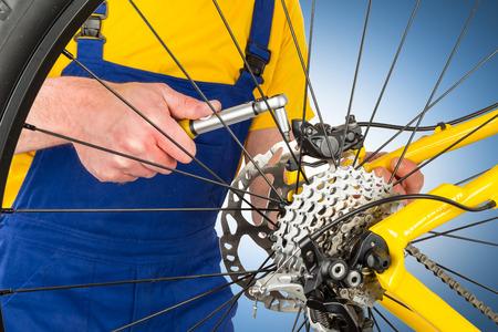 brake caliper: mounting brake caliper on yellow mountain bike Stock Photo