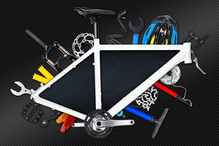 carbon fibre: bicycle frame with parts and empty blackboard on carbon fibre background