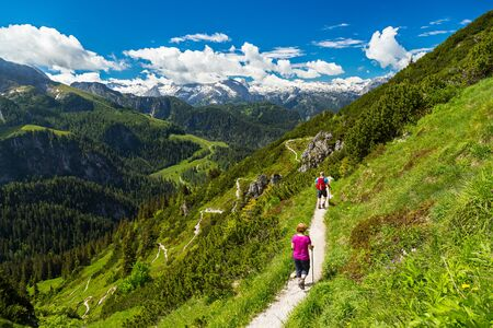 hikers on their way in the bavarian alps