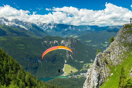 gliding: paraglider at the start from the top of mountain