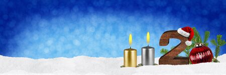 second sunday of advent concept xmas panorama blue background with candles ball bauble snow and red silver decorated fir branches