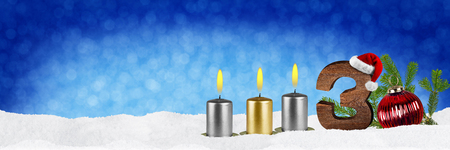 third sunday of advent concept xmas panorama blue background with candles ball bauble snow and red silver decorated fir branches Stock Photo