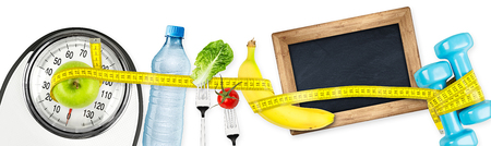 fitness diet motivation panorama  background concept water bottle apple banana salad tomatoe bathroom scale measuring tape and empty blackboard isolated on white background