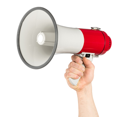 hand with red white bullhorn megaphone isolated background