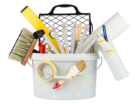 bubble level: paint bucket filled with renovation decoration diy tools isolated on white background