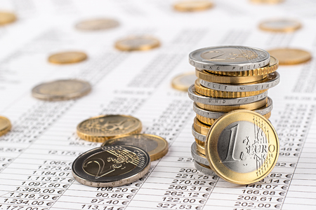 finance business accounting stock background with stack of euro coins on data sheet Stok Fotoğraf - 76561089