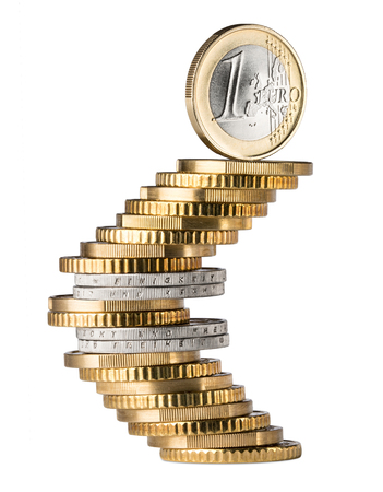 one euro coin standing on top of coin stack shaping the euro currency symbol isolated on white background