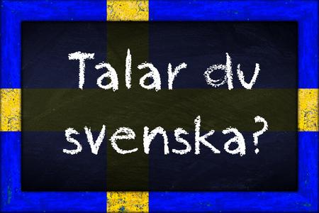 talar du svenska (translation: do you speak swedish) language education concept on chalkboard blackboard with wooden sweden flag frame