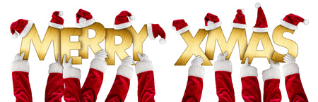 Santa hands holding up merry xmas christmas greeting golden shiny metal letters lettering with red white hats isolated wide panorama background
