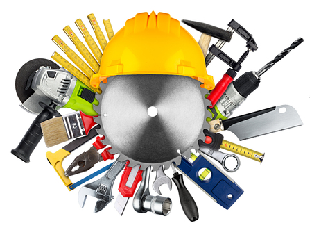 diy industrial concept tools behind buzz saw blade and building-site helmet isolated on white background Stock Photo