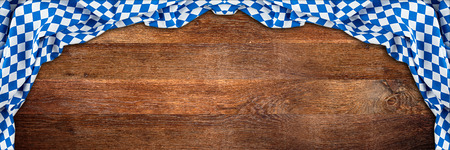 bavaria wooden rustic wood wide panorama background with white blue bavarian flag empty copy space Banco de Imagens