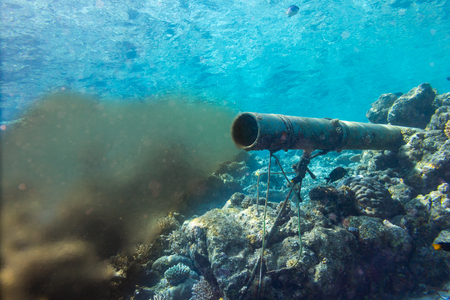 underwater sewer wastewater pipe in coral reef enviroment nature protection damage pollution sea ocean concept background Archivio Fotografico - 116778730