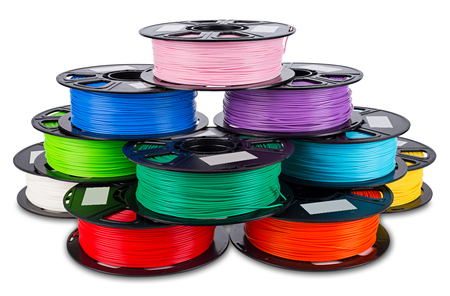 colorful bright stack pile of spool 3d printer pla abs filament plastic material isolated on white background