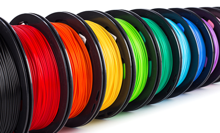 colorful bright wide panorama row of spool 3d printer pla abs filament plastic material isolated on white background Reklamní fotografie - 121536568