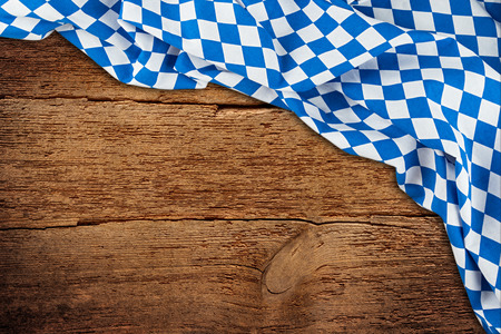 old rustic retro wood wooden texture with bavarian flag dark brown vintage weathered natural Oktoberfest background