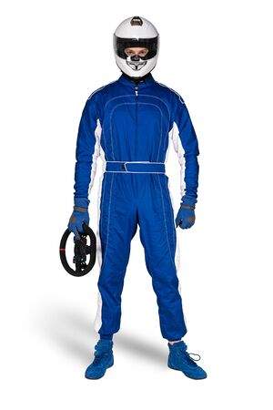 Determined race driver in blue white motorsport overall shoes gloves integral safety crash helmet and steering wheel isolated on white background. Car racing motorcycle gaming sport concept. Stockfoto