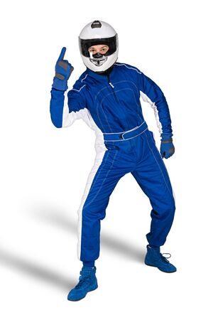 Determined race driver in blue white motorsport overall shoes gloves integral safety crash helmet and victory finger on white background. Car racing motorcycle gaming sport concept.
