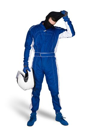Race driver in blue white motorsport overall shoes gloves and safety crash helmet take off blaclava after finish isolated on white background. Car racing motorcycle sport concept. Stockfoto