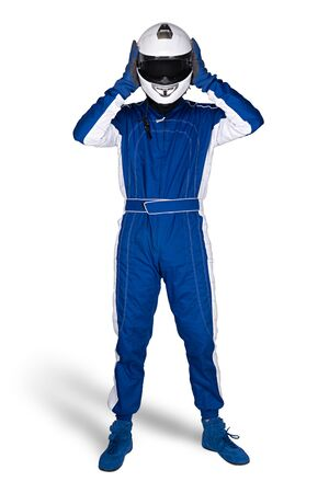 Race driver in blue white motorsport overall shoes gloves and safety gear take off crash helmet after finish isolated on white background. Car racing motorcycle sport concept.
