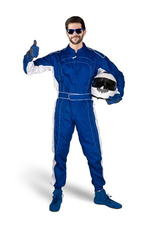Race driver in blue white motorsport overall shoes gloves and safety gear crash helmet shows thumbs up celebrating after winning isolated on white background. Car racing motorcycle sport concept.