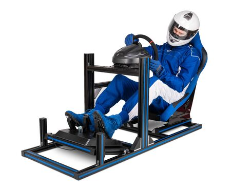 race driver in blue overall with helmet training on simracing aluminum simulator rig for video game racing. Motorsport car bucket seat steering wheel pedals isolated on white background