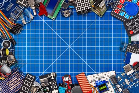 frame collage with copy space of microcontroller board display sensor button switches cable wire accessories and equipment electronics concept  panorama on blue cutting mat background