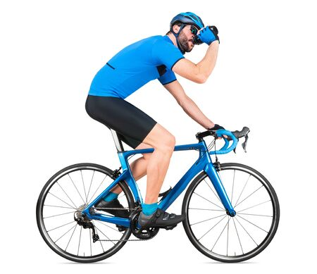 professional bicycle road racing cyclist racer  in blue sports jersey on light carbon race drinking out of water bottle. sport training cycling concept isolated on white background