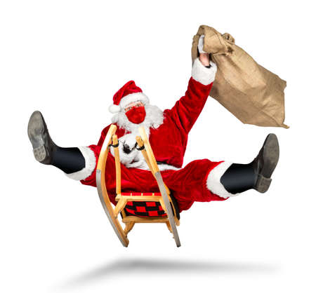 crazy santa claus with covid-19 coronavirus face breathing mask on his sleigh big red gift bag hilarious funny crazy xmas christmas present delivery isolated on white background Banque d'images