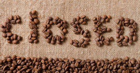 The word Closed from coffee beans on linea material  photo