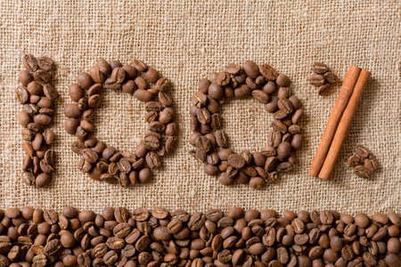 100% from coffee beans on linea material  Stock Photo
