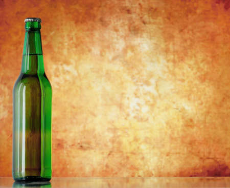 beer bottle on sacking with copy-space  photo