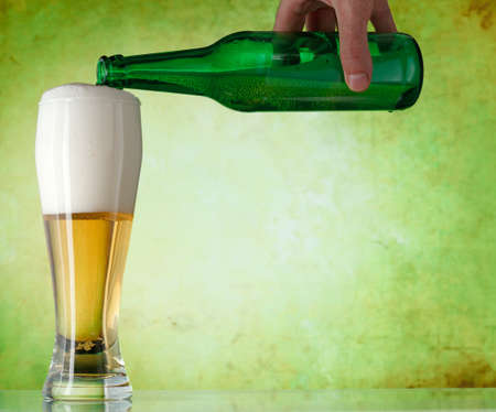 A beer being poured into a glass Stock Photo