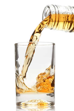 whiskey glass: whiskey being poured into a glass  Stock Photo