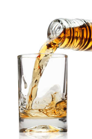 whiskey being poured into a glass  Stock Photo