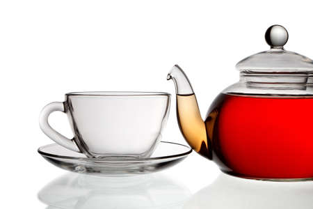 Teapot with tea and cup