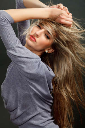 Portrait of a beautiful girl with flying blond hair  photo